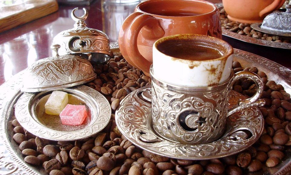 enjoying turkish coffee with dessert